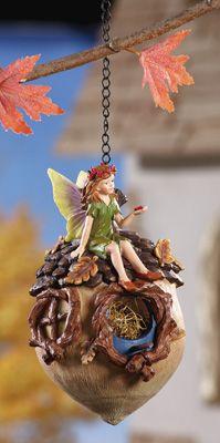 Green Fairy Sitting On Acorn Birdhouse