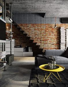 Industrial Chic style living room with exposed brick walls and concrete ceiling and floors