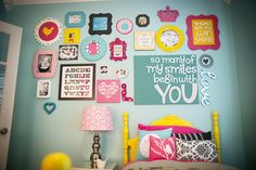 Amazing room filled with colors, prints, textures & this gallery of affirmations. By Ginny Phillips Photography.