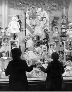 Girls Christmas 'window shopping' for dolls = I SO LOVE this image! I remember doing this as a little girl! It was MAGICAL!