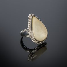 Mother of Pearl and sterling silver are combined in beautiful harmony in our Mother of Pearl ring. A sterling silver mother of pearl ring.