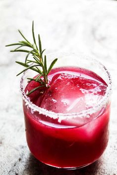 This ruby red Pomegranate Paloma is just the cocktail you need for the holidays! #Paloma #Pomegranate #Cocktail #tequilacocktails