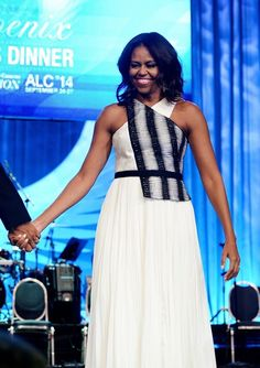 Michelle Obama Halter Dress - Michelle Obama stuns in a graphic black and white belted halter dress.