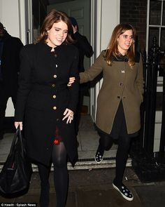 Festive spirit: Princesses Beatrice, right, and Eugenie, left, didn't want the fun to end ...