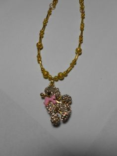 Gold pink and rhinestones  Poodle necklace by Purrwoof on Etsy, $12.00