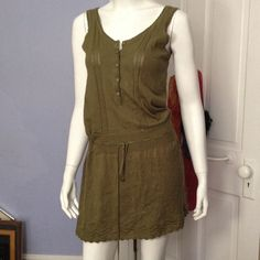 Olive green dress Olive green sleeveless dress. Worn once in great condition. Tapemeasure Dresses Midi
