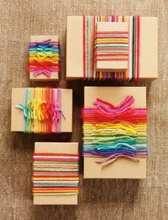 gifts tied with yarn - tutorial - wrap yarn in rainbow colors around gifts wrapped in tan or white butcher paper