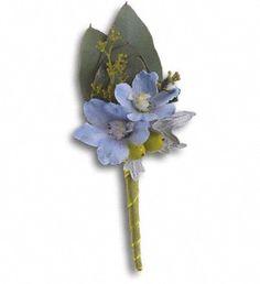 Light blue delphinium, green hypericum, dusty miller and seeded eucalyptus in a green taffeta ribbon.