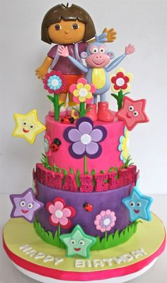 Love the Boots and Dora on this cake. the flowers and stars are a nice touch too.
