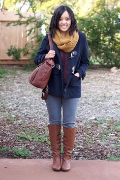 The perfect outfit for a cold day- navy coat, maroon shirt, mustard scarf, grey jeans and riding boots.