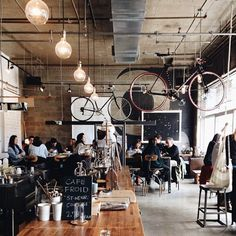 Love these lights.....Cafe Falco, Montreal And bikes hanging from the wall..genius!