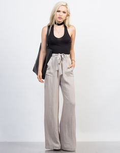 Make a fashion statement, and choose to step out in these Linen Palazzo Pants this summer. Pair these pants with a choker necklace, simple tank top or off-the-shoulder top, and ankle strap heels for a chic look.
