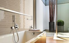 Country vision is a 2 caramel colored ceramic wall tile. London Country Vision Rail Molding is 2 inch caramel chair molding. Bad Inspiration, Bathroom Inspiration, Beautiful Wall, Beautiful Space, Mink, Mandarin Stone, Patchwork Tiles, Stone Basin, Basin Sink