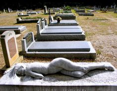"Artist: Peter Schipperheyn, born Melbourne Australia 1955-  Title:  ""Asleep""  carved 1987  Dimensions: 460 mm in height by 2020 mm in length by 800 mm in depth [life-size figure].  Medium: Carrara Statuario Marble .  Present location: Mt Macedon Cemetery, Mt Macedon. Victoria."