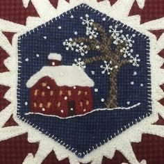 Wintertime--cut out windows and place yellow wool behind; Stem stitch ground whipped w/ #4 Krenik braid; Stars/flakes Ermine stitch &Colonial Knots 1 strand floss and #4 Krenik braid, blanket stitch #8 Perle cotton around edge of hexagon.