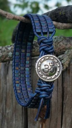 Items similar to Om Yoga Bracelet/Pewter Om button/denim blue ultra soft leather/Czech matte iridescent blue glass czech cube/Namaste/off the beadin path on Etsy - Schmuck