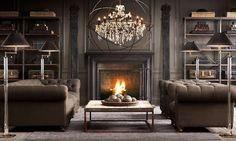 Facing sofas using large chandelier to enhance focal point of fireplace