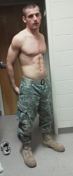 Shirtless lad in military uniform