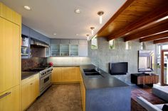 Architecture, Prepossessing Kitchen Filled With Timber Kitchen Counter Uniting With Chrome Oven And Burner Also Unique Grey Timber Cabinet Above: Beach House with Traditional Wooden Decor and Stylized with Modern Furniture