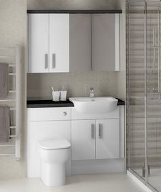 White Gloss Fitted Bathroom Furniture - This cosmopolitan family bathroom shows White Gloss fitted furniture at its best. Styling the room with simple colours really helps to create an uncluttered, spacious look. Bathroom Vanity Units, Bathroom Photos, Bathroom Ideas, Family Bathroom, Upstairs Bathrooms, Fitted Bathrooms, Ideal Bathrooms, Fitted Bathroom Furniture, Timeless Bathroom