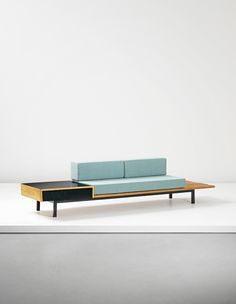 Charlotte Perriand; Oak, Enameled Metal and Plastic Laminate Sofa with Drawer and Side Table from Cité Cansado, c1958.