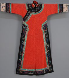 China, silk summer robe, red gauze trimmed with polychrome ribbon and brocade, having butterflies and flowers and pierced brass buttons, mid 20th c