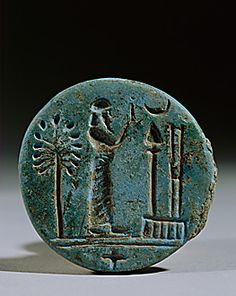 Round Seal: A priest in prayer before the symbols for Marduk, chief god of Babylon, and Nabu, god of wisdom and writing. Neo-Babylonian, 7th-6th BCE. Blue glazed clay, 4.5 cm across | Department of Oriental Antiquites, Louvre, Paris, France