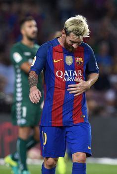 Barcelona's Argentinian forward Lionel Messi leaves the pitch at the end of the Spanish league football match FC Barcelona vs Deportivo Alaves at the Camp Nou stadium in Barcelona on September / AFP / LLUIS GENE Messi 2017, Good Soccer Players, Camp Nou, September 10, Football Match, Lionel Messi, Fc Barcelona, Pitch, Leo