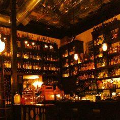 Snug bar serving aged spirits, bespoke drinks, global bites & more in a retro, bottle-adorned space.