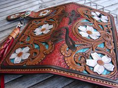 "$950.00. (really) Sheridan style with flowers,leaves, scrolls and ""divine wind"" kanji down the spine...Japanese style biker wallet handtooled by hollywoodriffraff"