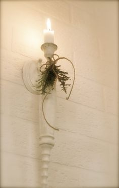 Candle sconce. Would be neat to use an old fancy rolling pin for this project.