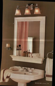 Framed bathroom mirror and shelf but with a hole in the shelf for a mason jar for my toothbrush :)