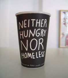 A disposable coffee cup with a message.