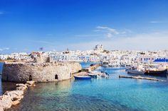 Enjoy the views of cobalt blue waters around Paros
