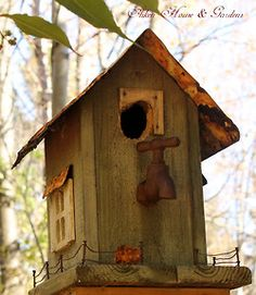 birdhouse from found objects..love the spigot as a perch