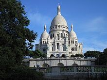 Montmartre is primarily known for the white-domed Basilica of the Sacré Cœur on its summit and as a nightclub district
