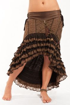 BOHEMIAN POETRY HANDMADE FRILL SKIRT :- The skirts are hand made with heaps of love and attention to detail. Decorated with chain and feathers One size fits all. Made from a combination of Lycra , Lace , Leather and Suede.