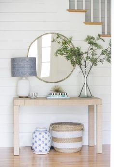 Maybe a console table instead of the small dresser, toy basket room underneath...