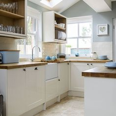 Omg this is my kitchen! Pale blue and cream kitchen Duck-egg walls, cream Shaker-style units and wooden worktops create a light, fresh feel in this country kitchen. Pale blue kitchen accessories complete the look. New Kitchen, Kitchen Dining, Kitchen Decor, Blue Walls Kitchen, Small Kitchen Diner, Green Kitchen, Dining Room, Sweet Home, Cuisines Design