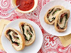 Use store-bought dough to make these Venetian Rolled Pizzas. Filled with mozzarella, spinach and proscuitto, they make a satisfying and fun hand-held dish.