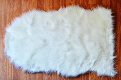 Spoted Tiffany D sheepskin $40 @ lulu & georgia. pairing with ghost armchair.