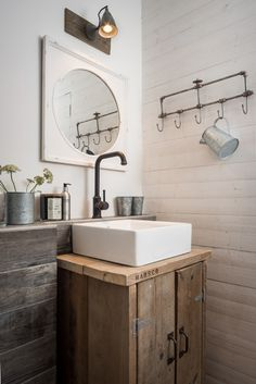 Home Remodel Interior love this modern rustic coastal bathroom with rustic wooden sink unit, galvanised jug and flower pots, reclaimed wood rustic panelling and industrial metal taps, hooks and wall ight Beach House Bathroom, Beach House Decor, Beach Houses, Master Bathroom, Bathroom Modern, Industrial Chic Bathrooms, Small Cabin Bathroom, Seaside Bathroom, Rustic Bathroom Lighting