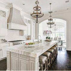 Beautiful kitchen by Renovation Interiors! #kitchen #kitchendecor #kitchendesign #whitekitchen #chandelier #crownmolding #hardwoodfloors…