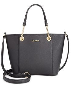"""Calvin Klein makes the most of the mini trend with this tailored satchel, complete with chic chain-link handles and a crossbody strap for versatility.   Faux leather   Imported   Mini sized bag; 7""""W x"""