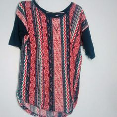 Red and blue Aztec Design tee. Very soft. Barely worn. Sleeves fitted to your arm. Scoop neck. Rounded bottom. Aztec design Rue 21 Tops Tees - Short Sleeve