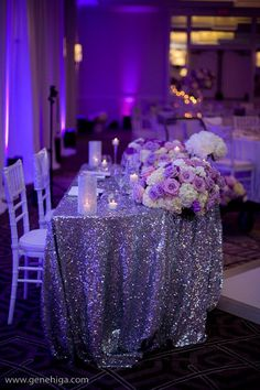 Glittery tables with purple accents Found on http://sdweddingscene.com http://www.simplyelegantconsulting.com
