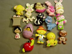 Avon Pin Pals - they had a solid perfume inside.  I'd often get them as stocking stuffer gifts or in my Easter basket.