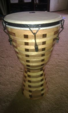 """This is a 12"""" Djembe Drum built here at Bonehead Custom Creations. Head and Hardware by Toca. It is currently for sale priced at $399.00. Made on a scroll saw."""