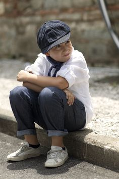 I must remember to dress my kids like this occasionally.  Rolled-up casual jeans, a simple white shirt, and old sneakers.  Fantastic.