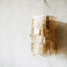 lamp shade made from recycled sewing patterns, from umbu on etsy